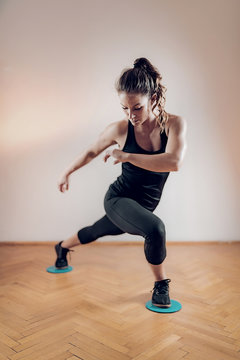 Woman Exercising with Sliding Fitness Discs