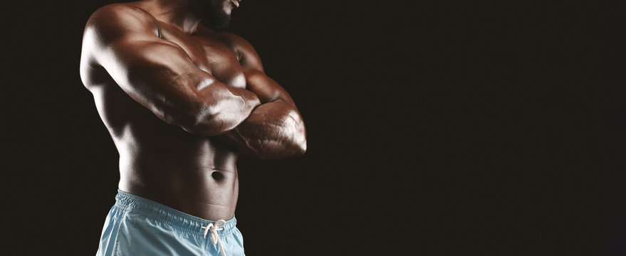 Cropped image of african american bodybuilder with arms crossed