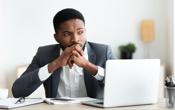 Thoughtful african entrepreneur getting nervous on workplace