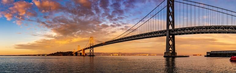 Colorful panorama of the San Francisco bay bridge at sunset
