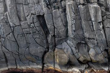 Foto auf Acrylglas Grau Abstract black lave basalt rock formation walls at the Ponta do Mistério on Terceira Island, Azores