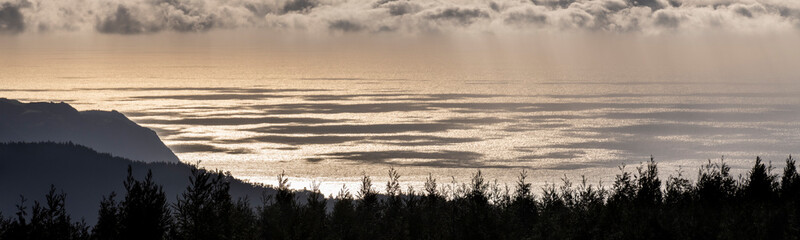 Recess Fitting Gray traffic landscape panorama with pine forests, the ocean water with cloud shadows and sunlight reflection, looking down from Castelo Branco