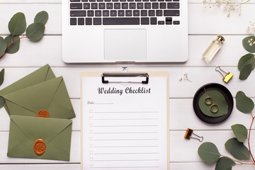 Planning wedding with ideas from the internet on laptop