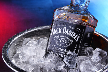 Bottle of Jack Daniel's bourbon in bucket with crushed ice
