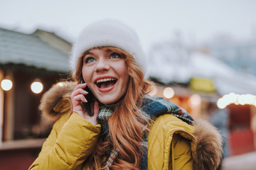 Fototapete - Cheerful red-haired female person talking per telephone