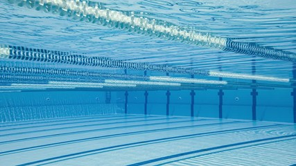 Fototapete - Olympic Swimming pool under water background.