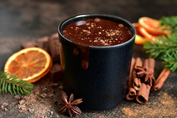 Homemade christmas hot chocolate with orange and spices.