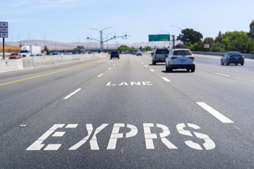 Express Lane marking on the freeway; San Francisco Bay Area, California; Express lanes help manage...
