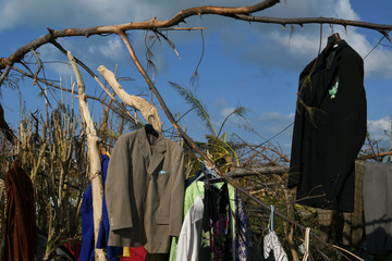 Clothes are seen hung from tree limbs to dry in a destroyed neighborhood in the wake of Hurricane Dorian in Marsh Harbour
