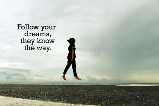 Dream Inspirational quote - Follow your dreams, they know the way. With young woman walking and  then fly with blue gloomy sky background. Words of wisdom with levitation concept. Walk on air.