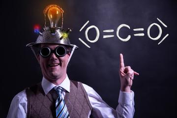 Nerd presenting handdrawn chemical formula of co2