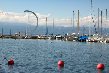 Three red buoys in the beautiful harbour in Ouchy in Lausanne, Switzerland in summer 2019.