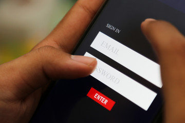 attractive hands writing sign username on a smart phone