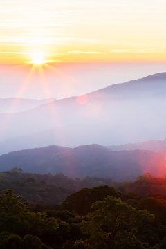 Bright sunrise over the mountain peak.