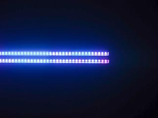close up on blue LED light in black background