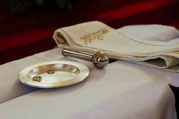 close-up of wedding rings before the wedding sacrament