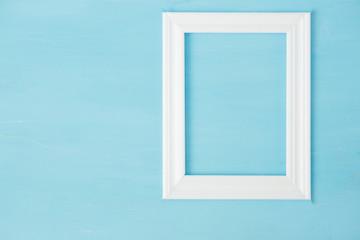 Vintage white mockup, frame on blue wooden bacground