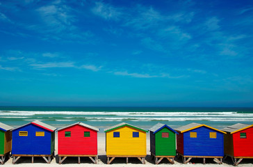 Multi-colored beach houses on the background of the sea