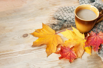 hot coffee or cappuccino and autumn leaves on a wooden table, autumn comes soon, Autumn decor, fall mood, autumn still life