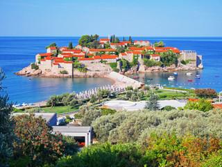 Sveti Stefan island and beach in sunny summer day, Budva, Montenegro. Vew of top