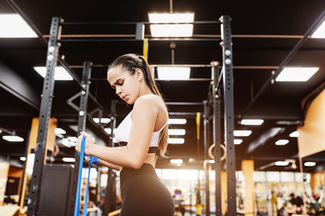 Beautiful young girl professional triathlete is preparing for a competition and is known in the gym. The concept of a healthy lifestyle and professional sports career