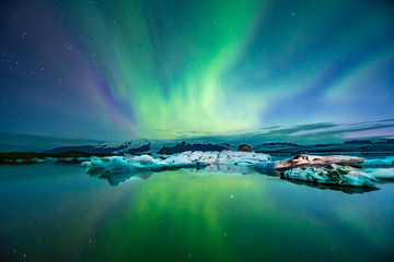 Wall Murals Green blue Northern Lights In Iceland