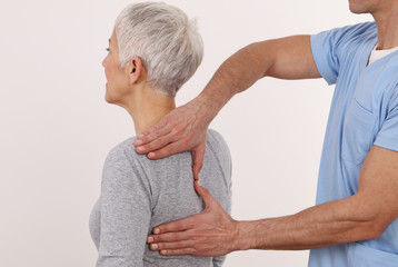 Back pain , Physiotherapy. Woman Chiropractic pain relief adjustment /Kinesiology treatment . Osteopathy practitioner