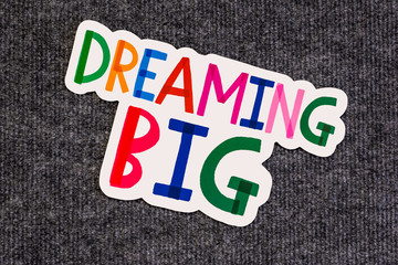 Dreaming big words on blackboard with colorful alphabets.