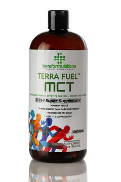 Terra Fuel MCT logo on plastic bottle isolated on white background with reflection