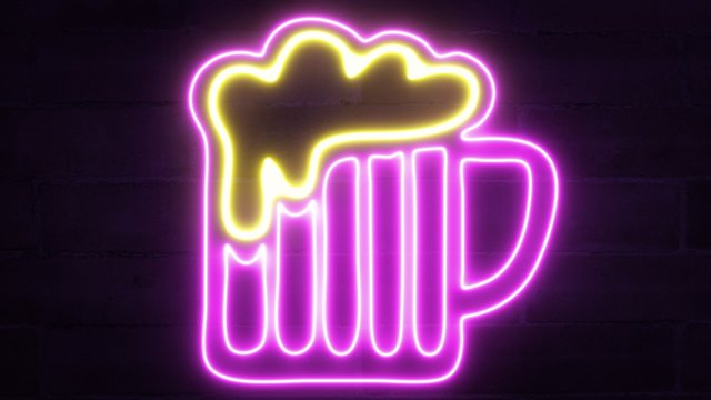 A neon sign showing a pink-purple big beer mug with an overflowing yellow foam, flickering against a dark brick wall.