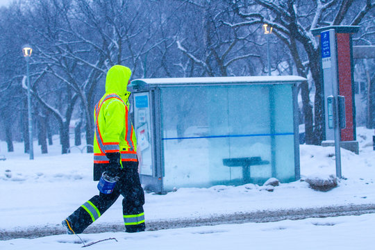 Canadian construction worker in winter walking in the snow