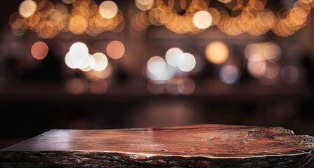 Wood texture table top (counter bar) with blur light gold bokeh in cafe,restaurant background