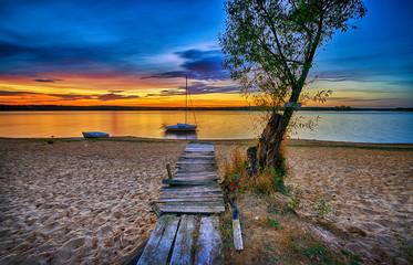 Foto auf Acrylglas Cappuccino Beautiful summer sunset on sea shore
