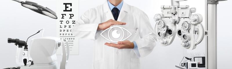 concept of eye examination, optician hands protecting an eye icon, prevention and control, on background tools for diagnostics, web banner