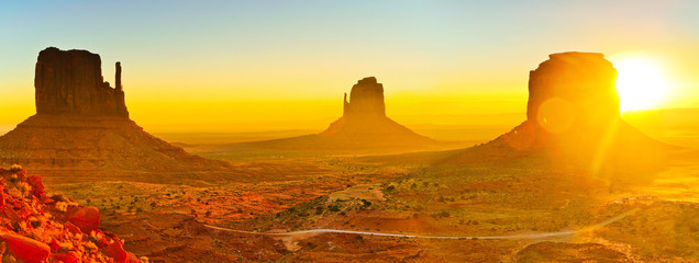 View of Monument Valley at sunrise near the border of Arizona and Utah in Navajo Nation Reservation in USA.
