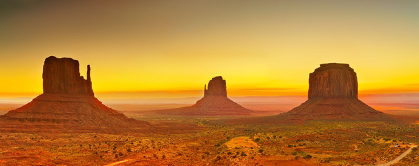 Foto op Canvas Meloen View of Monument Valley at sunrise near the border of Arizona and Utah in Navajo Nation Reservation in USA.