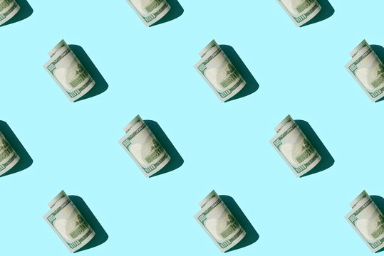 Pattern with money american hundred dollar isolated on blue background.