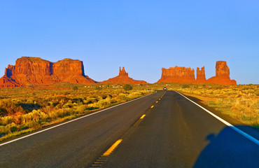 View of Monument Valley at sunset on the Highway 163 in Navajo Nation Reservation in USA.