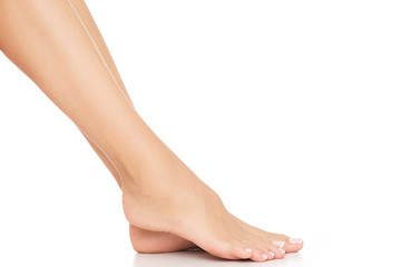 Wall Murals Pedicure Tiny, female feet with delicate skin and perfectly done pedicure.