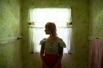 woman in silhouette in window