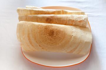 Kerala crispy dosas in a plate