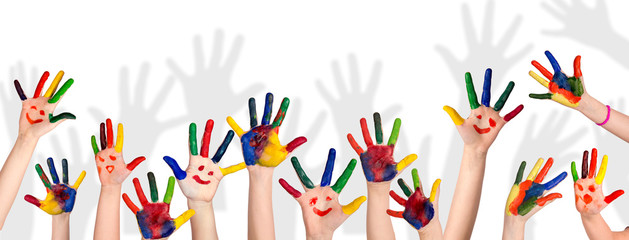 Children's smiling colorful hands raised up. The concept of classroom or back to school