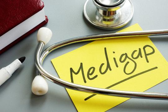 Medigap or medicare supplement insurance inscription and stethoscope.