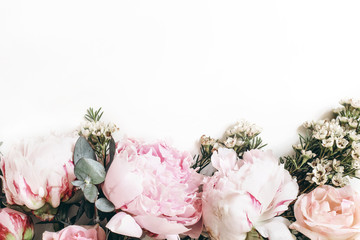 Poster Bloemen Decorative web banner made of beautiful pink peonies, rosies and eucalyptus isolated on white background. Feminine floral frame composition. Styled stock photo.Empty space. Flat lay, top view.