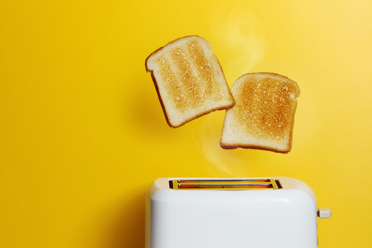Slices of toast jumping out of the toaster