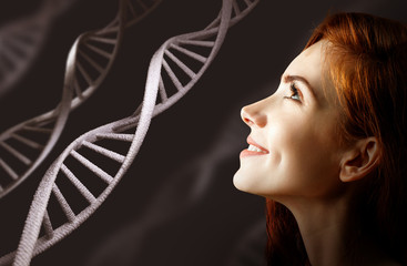 Portrait of sensual redhead woman among white DNA chains.