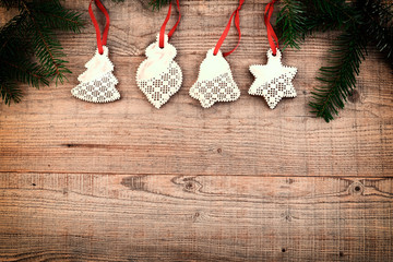 Christmas background with fir tree and decor. Gingerbread cookies on wooden background.