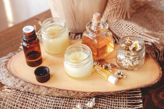 Hand cream and lip balm in a glass jar. Natural organic cosmetics with honey, wax and oils.