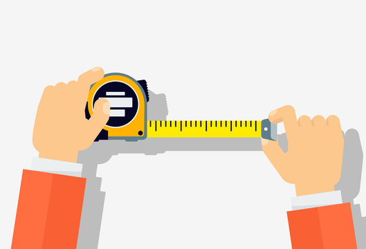 Measuring tape in the hands of a man.