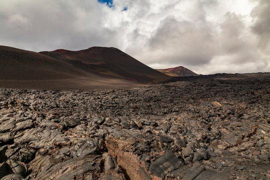 Rough surface of frozen lava after Mauna Loa volcano eruption, Hawaii, USA